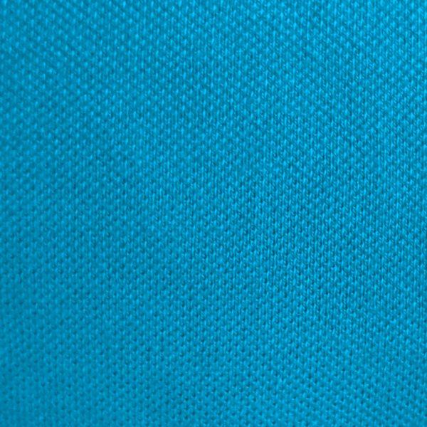 Detalle del tejido del polo de hombre modelo greensome color azul