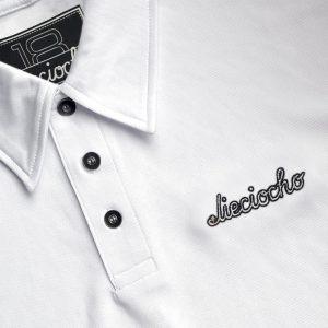 Detalle del polo de golf de hombre modelo foursome color blanco