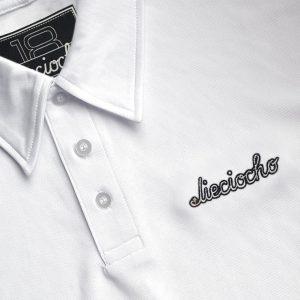 Detalle del polo de golf de niño modelo foursome color blanco