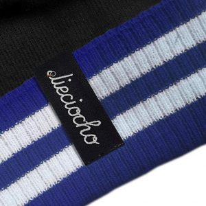 detalle gorro golf modelo par colores negro azul y blanco