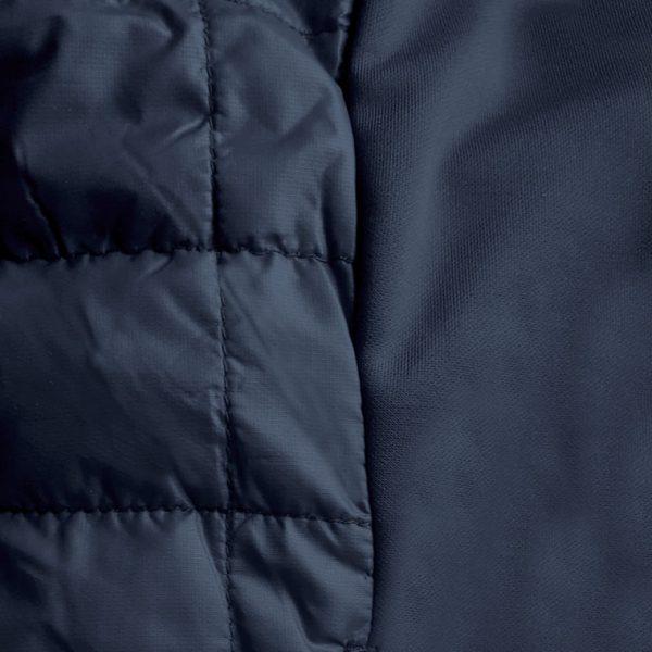 Detalle del tejido chaleco de golf de mujer modelo caddie color azul marino
