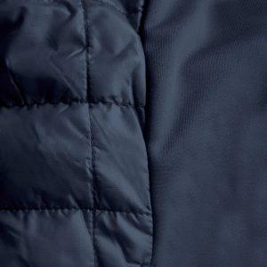Detalle del tejido chaleco de golf de hombre modelo caddie color azul marino