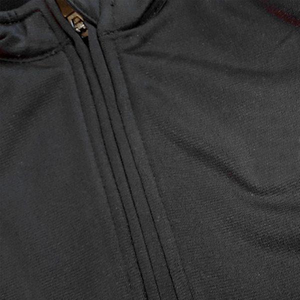 Detalle sudadera de golf técnica de mujer color negro modelo foursome