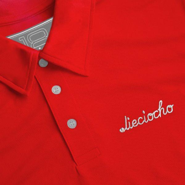 Detalle del polo de golf de hombre modelo foursome color rojo