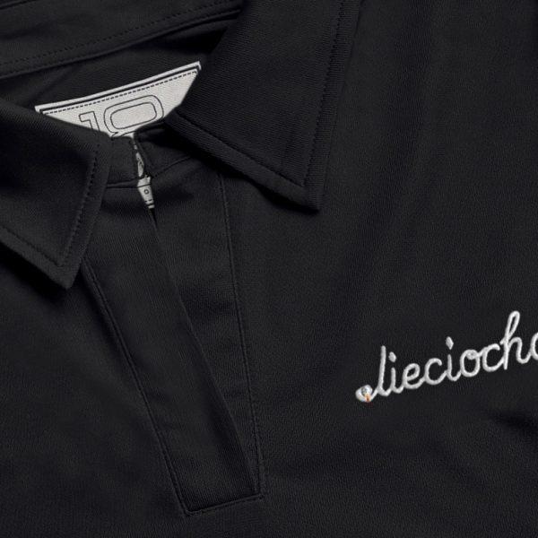 Detalle del polo de golf de mujer modelo foursome color negro
