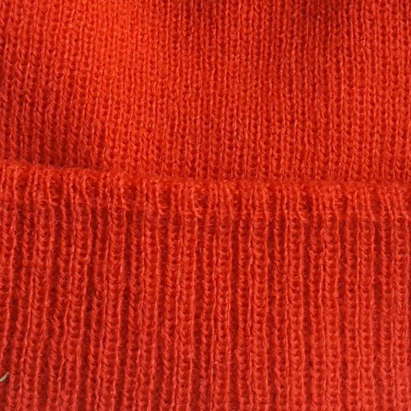 detalle tejido gorro de golf de niño modelo caddie color rojo