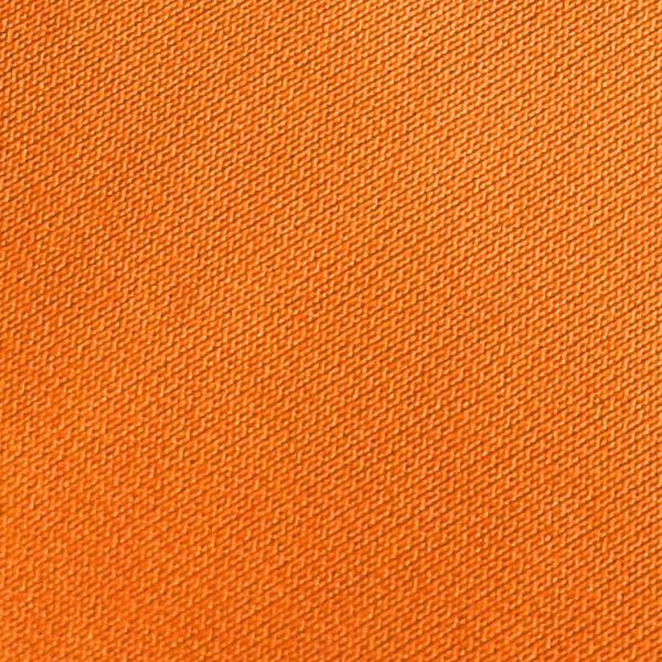 Detalle tejido polo de golf modelo draw mujer naranja