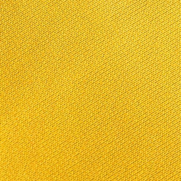 Detalle tejido polo de golf modelo draw mujer amarillo