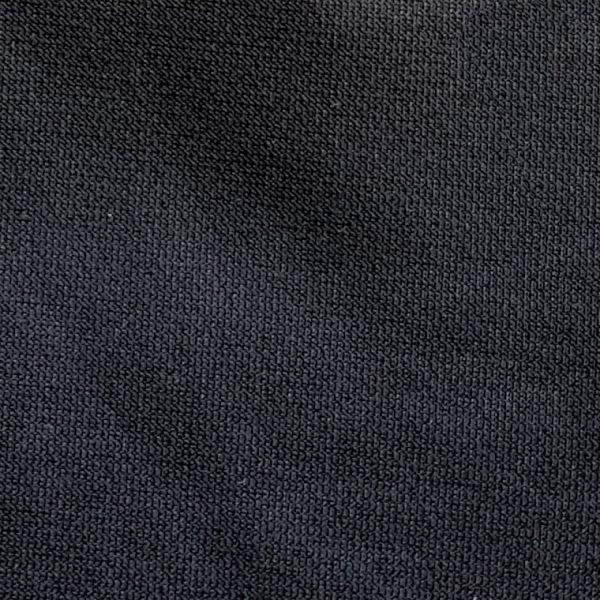 Detalle tejido polo de golf modelo fade hombre negro