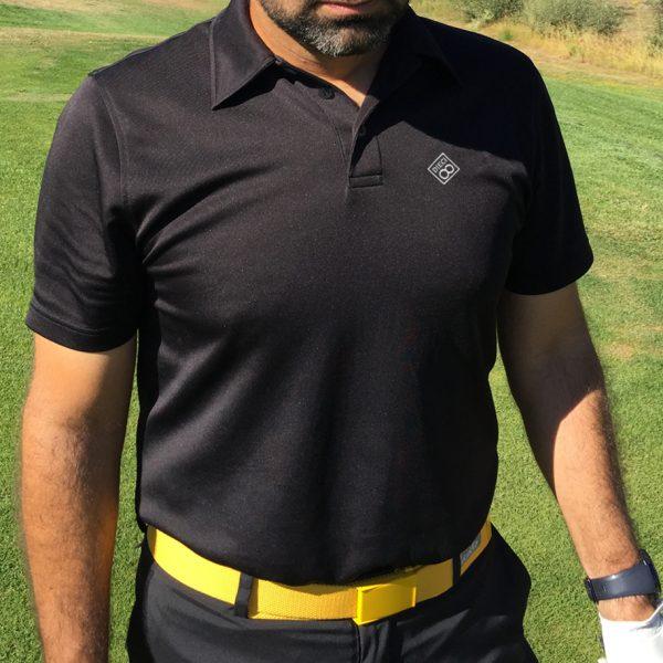 polo negro de golf modelo spin hombre