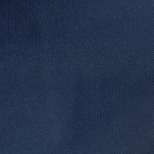 detalle tejido polo de niño color azul marino modelo driver