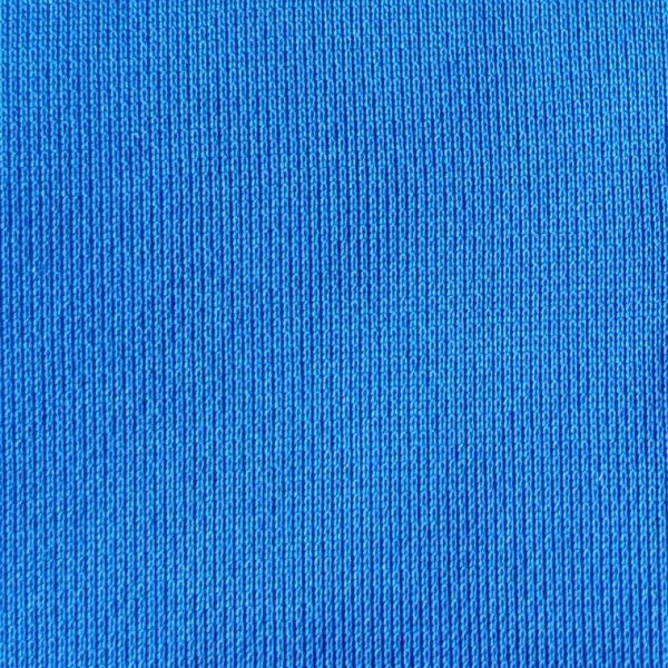 detalle tejido polo de golf de niño color azul modelo stroke
