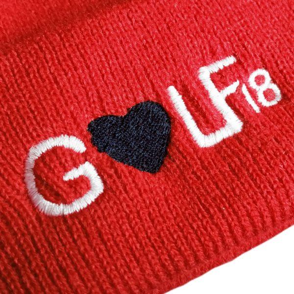 detalle-gorro-rojo-love-golf-dieciocho